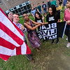 KRISTOPHER RADDER - BRATTLEBORO REFORMER<br /> Keith Lyman, the principal at Brattleboro Area Middle School lowers the American Flag so Mikaela Simms, the diversity coordinator for the Windham Southeast Supervisory Union, and Diamond Bedward, Kia Adams, and Mya Satchell, eighth-grade students at Brattleboro Area Middle School, can raise the Black Lives Matter flag underneath it, during Diversity Day on Friday, May 4, 2018.