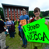 KRISTOPHER RADDER - BRATTLEBORO REFORMER<br /> Kate Salomon holds a sign at a rally to support New England Center for Circus Arts' coaches and founders at the new trapezium building on Putney Road on Friday, July 14, 2017.