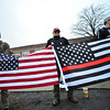 KRISTOPHER RADDER - BRATTLEBORO REFORMER<br /> Brattleboro Union High School students Waylon Linn-Adams, 9th grade, Ethan Bristol, 10th grade, and Cater Weeks, 10th grade, hold onto a flag while supporting the second amendment before the start of classes on Friday, March 30, 2018.