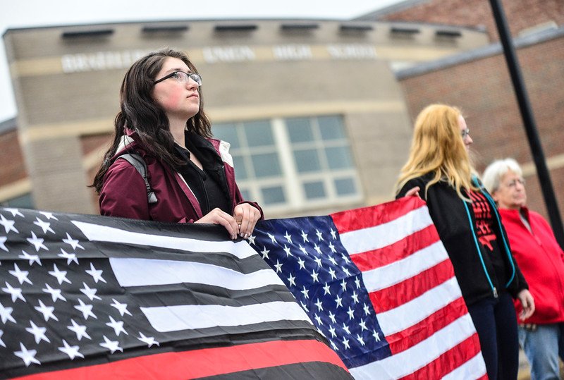 KRISTOPHER RADDER - BRATTLEBORO REFORMER<br /> Megan Pennell, a 12th grader at Brattleboro Union High School, stood with her fellow students to show support for the second amendment before the start of classes on Friday, March 30, 2018.