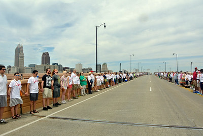 DAVID KNOX / GAZETTE The climax of the Circle the City with Love rally sees the more than 2,000 demonstrators cross the landmark bridge spanning the Cuyahoga River and join hands in silence for 30 minutes.