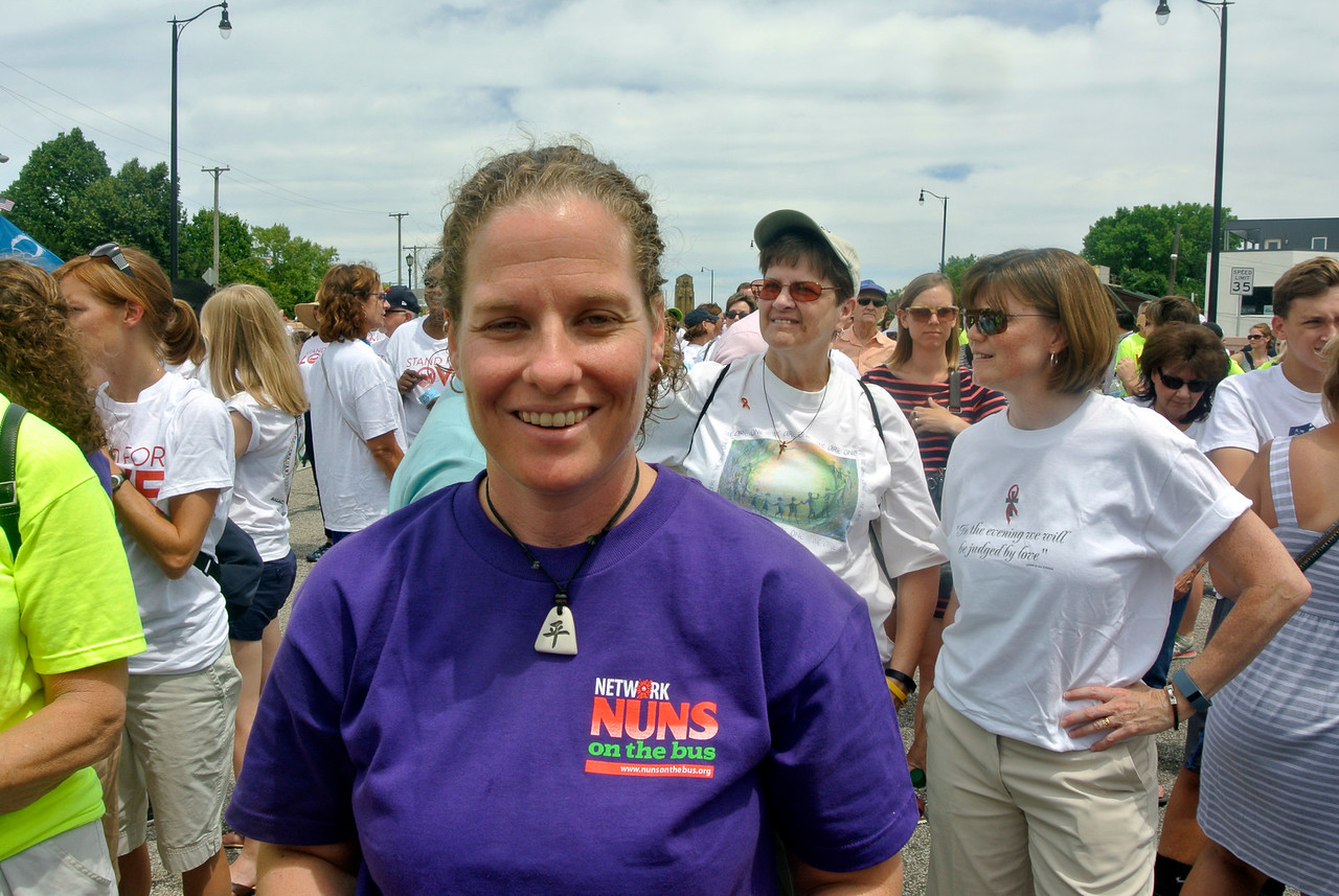 DAVID KNOX / GAZETTE Sister Erin Zubal, an Ursuline nun from Cleveland, is a member of the Nuns on the Bus group that participated in the Circle the City with Love rally Sunday on Cleveland's historic Lorain-Carnegie Bridge.