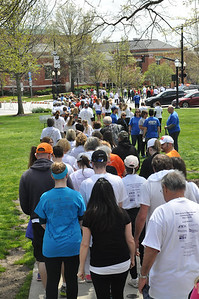 ASHLEY FOX / GAZETTE More than 300 people joined together to walk the Medina Square, honoring loved ones lost to suicide. Sunday marked the fourth year of the event.