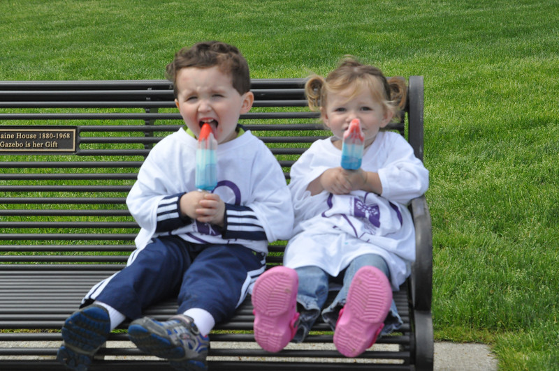 ASHLEY FOX / GAZETTE Colin McFarland, 3, of Wadsworth and Olivia Dieter, 1, of Norton, enjoy the spring breeze in the Medina Square on Sunday afternoon. The kids attended a suicide awareness walk with their families.
