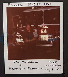This 1993 photo shows Tyler fire fighter Jim Mullicane holding Raniqua Franklin, then age 3, after he rescued her from a fire. Franklin, now 30, was reunited with the fire fighters at Fire Station 1 on Friday, June 5, 2020.