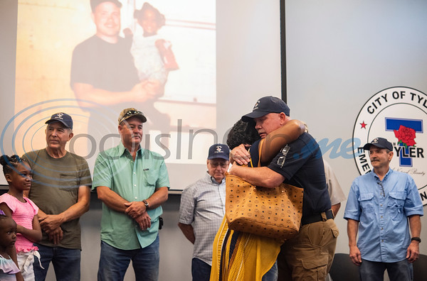 Raniqua Franklin, 30, embraces Tyler fire fighter Jim Mullicane who rescued her from a fire when she was three years old and found unconscious and not breathing Franklin was reunited with the fire fighters who worked the 1993 fire at Fire Station 1 on Friday, June 5, 2020.