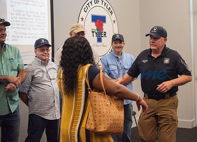 Raniqua Franklin, 30, opens her arms to embrace Tyler fire fighter Jim Mullicane who rescued her from a fire when she was three years old and found unconscious and not breathing Franklin was reunited with the fire fighters who worked the 1993 fire at Fire Station 1 on Friday, June 5, 2020.