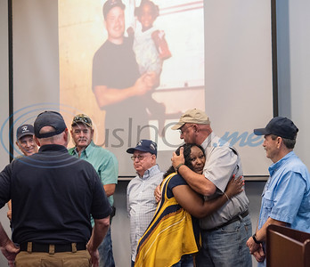 Raniqua Franklin, 30, embraces Mike Willis, one of several fire department employees who worked the scene of a fire at her home in Tyler where Franklin was found unconscious and not breathing in 1993 when she was three years old. Franklin was reunited with the fire fighters at Fire Station 1 on Friday, June 5, 2020.