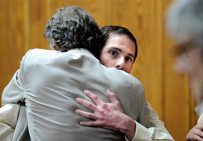 Adam Raszynski hugs defense attorney Seth Temin after hearing the not guilty verdict on Friday, March 23, during the second-degree murder trial of Adam Raszynski at the Boulder County Justice Center in Boulder. Raszynski was on trial for the murder of his mother Rita Redford but will be released from custody after being found not guilty. For a video interview with the defense council go to www.dailycamera.com Jeremy Papasso/ Camera