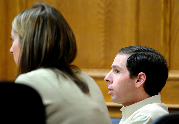 """Adam Raszynski sits next to defense attorney Kathryn Herold while waiting for the jury's verdict on Friday, March 23, during the second-degree murder trial of Adam Raszynski at the Boulder County Justice Center in Boulder. Raszynski was on trial for the murder of his mother Rita Redford but will be released from custody after being found not guilty. For a video interview with the defense council go to  <a href=""""http://www.dailycamera.com"""">http://www.dailycamera.com</a><br /> Jeremy Papasso/ Camera"""