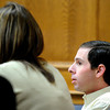 "Adam Raszynski sits next to defense attorney Kathryn Herold while waiting for the jury's verdict on Friday, March 23, during the second-degree murder trial of Adam Raszynski at the Boulder County Justice Center in Boulder. Raszynski was on trial for the murder of his mother Rita Redford but will be released from custody after being found not guilty. For a video interview with the defense council go to  <a href=""http://www.dailycamera.com"">http://www.dailycamera.com</a><br /> Jeremy Papasso/ Camera"
