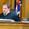 "The Honorable Thomas F. Mulvahill reads a not guilty verdict to the courtroom on Friday, March 23, during the second-degree murder trial of Adam Raszynski at the Boulder County Justice Center in Boulder. Raszynski was on trial for the murder of his mother Rita Redford but will be released from custody after being found not guilty. For a video interview with the defense council go to  <a href=""http://www.dailycamera.com"">http://www.dailycamera.com</a><br /> Jeremy Papasso/ Camera"