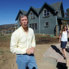 "Richard Nuzzi talks about the day his previous home burned to the ground. His wife Stephanie O'Hearn is on the right in front of their new home.<br /> Richard Nuzzi and Stephanie O'Hearn are near completion of rebuilding their home after losing the previous one in the Four Mile Canyon Fire last year.<br /> For a video and more photos from the fire rebuilding, go to  <a href=""http://www.dailycamer.com"">http://www.dailycamer.com</a>.<br /> Cliff Grassmick / August 24, 2011"