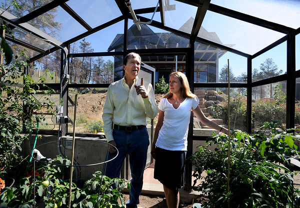 """Richard Nuzzi and Stephanie O'Hearn are inside their new greenhouse talking about gardening.<br /> Richard Nuzzi and Stephanie O'Hearn are near completion of rebuilding their home after losing the previous one in the Four Mile Canyon Fire last year.<br /> For a video and more photos from the fire rebuilding, go to  <a href=""""http://www.dailycamer.com"""">http://www.dailycamer.com</a>.<br /> Cliff Grassmick / August 24, 2011"""
