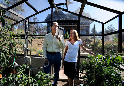 Richard Nuzzi and Stephanie O'Hearn are inside their new greenhouse talking about gardening. Richard Nuzzi and Stephanie O'Hearn are near completion of rebuilding their home after losing the previous one in the Four Mile Canyon Fire last year. For a video and more photos from the fire rebuilding, go to www.dailycamer.com. Cliff Grassmick / August 24, 2011