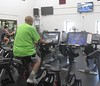 Chadron State College psychology faculty member Marv Neuharth pedals on one of the Expresso Bikes at the Nelson Physical Activity Center. In June 2018, Neuharth surpassed one billion points playing a video game that is among the riding programs on the stationary bicycle, one of 23 cardio workout machines available at the NPAC. (George Ledbetter photo)