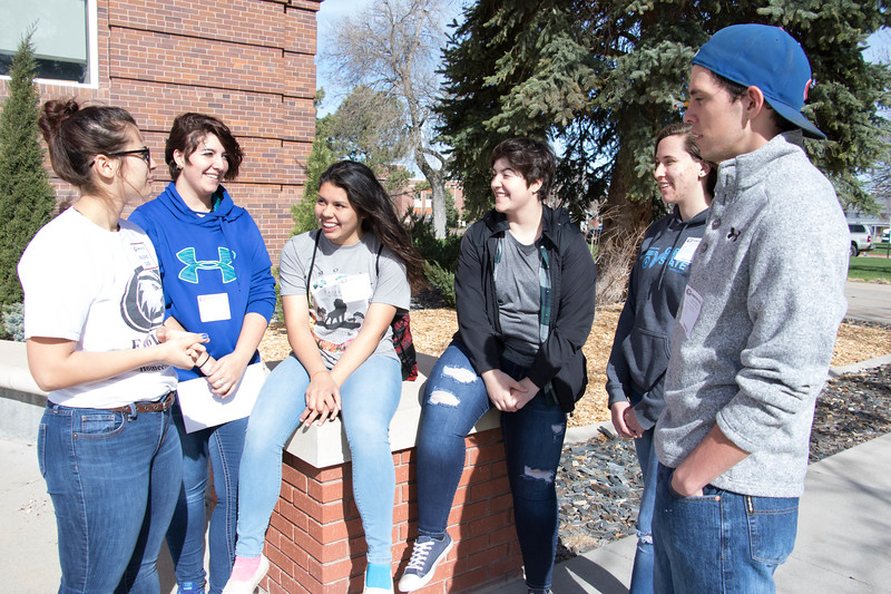 Chadron State College student Gabi Perez, left, visits with Bennett County High School students, from left to right, Joss Hellman, Josie May, Kaitlyn Hellman, Nicole Goetzinger and Garrett Hodson Friday, April 7, 2017, during the 57th Annual Scholastic Day. (Photo by Tena L. Cook/Chadron State College)