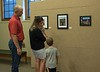 A family views the Unity Through Community photo exhibit featuring Nebraska landscapes. The show is open in the Mari Sandoz High Plains Heritage Center through Aug. 3, 2018. (Photo by Tena L. Cook/Chadron State College)