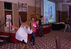Becky Jo Wylie, left, and Mirka Anguiano, both of Scottsbluff, take part in an exercise demonstrating a healthy way for pre-school children to express their anger during the 30th annual Excellence in Early Childhood Conference Saturday, Feb. 16, 2019, in the Student Center. (Tena L. Cook/Chadron State College)