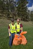 Chadron State College Art Guild members Kayla Anderson of Gothenburg, Neb., left, and Serena Brooks of Glenrock, Wyo., right, pose while cleaning up Highway 20 east of Chadron for The Big Event Saturday, April 22, 2017. (Photo by Tena L. Cook/Chadron State College)