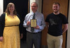 Members of Chadron State College's Phi Beta Lambda club, Leyna Brummels, left, and Dawson Brunswick, right, pose for a photo with Jim Gardner after presenting him with the 2017 Nebraska Phi Beta Lambda State Leadership Conference Business Person of the Year award, Tuesday, May 2, 2017. (Courtesy photo)