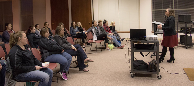 Crowd members attending a Diversity Committee program for Women's History Month, listen as Sara Smith answers questions about her college internships at Walt Disney World, Tuesday, March 28, 2017, in the Student Center. (Photo by Kelsey R. Brummels/Chadron State College)