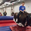Jett Jelinek rides the mechanical bull during Spring Daze in the Chicoine Center Friday, April 21, 2017. (Photo by Tena L. Cook/Chadron State College)