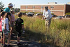 Chadron State College Horticulturist Lucinda Mays shows students and staff from the Chadron Intermediate After-School Program Gardening Club how to identify big bluestem grass Monday, Sept. 17, 2018, near the Math and Science Building. (Photo by Kelsey R. Brummels/Chadron State College)