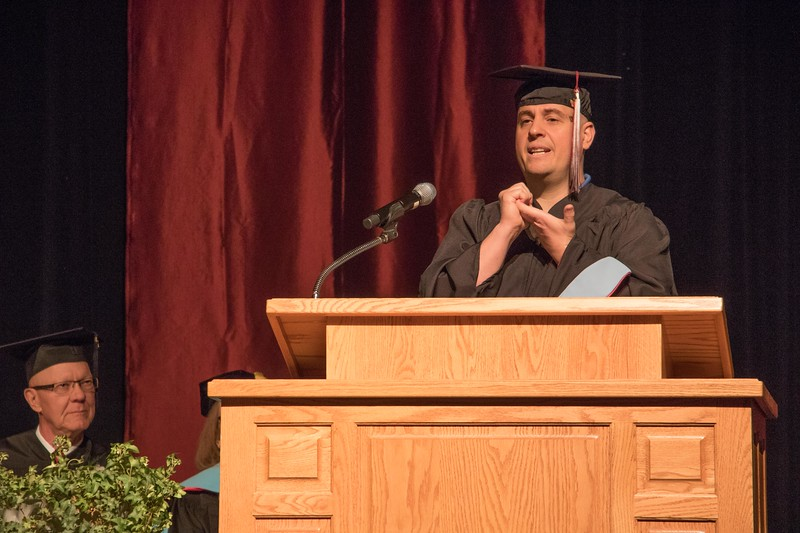 During his opening moment of reflection in the master's ceremony, Jorge Pla Redondo demonstrates there are gentle ways to accomplish goals instead of using force. (Photo by Tena L. Cook/Chadron State College)