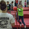 From left,  Chadron school children Haiven Catches, Lucas Soester, and Rylan Barry run through the Obstacle Course during Challenge Days at Chadron State College Wednesday, April 5, 2017. (Photo by Alex Coon/Chadron State College)