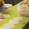 CSC Dining Services staff members place 2,017 overlapping tortillas in a line on tables in the Chicoine Center Friday, April 21, 2017, in an attempt to set the world record for longest taco line during Spring Daze. (Photo by Tena L. Cook/Chadron State College)