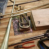 Pieces of Dr. Sid Shuler's partially finished trumpet await assembly on a workbench. (Photo courtesy Sid Shuler)