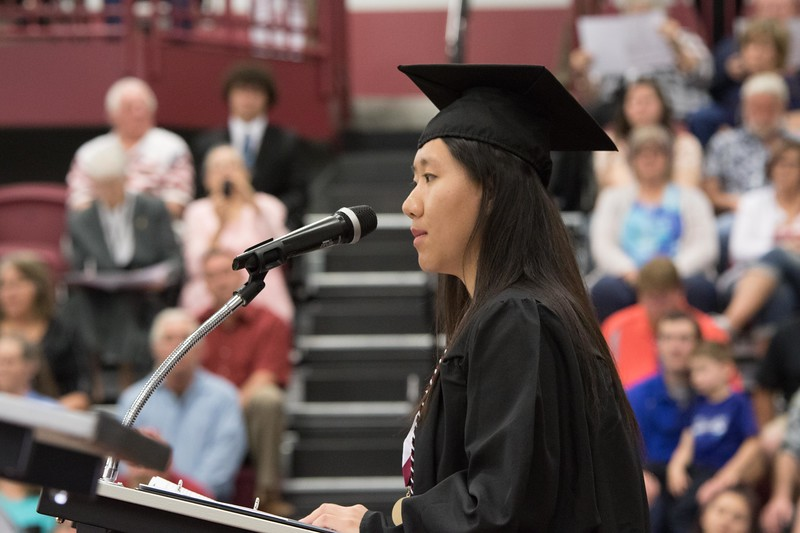 Yuxuan Zhang offers the opening moment of reflection during Chadron State College's undergraduate commencement in the Chicoine Center May 6, 2017.  (Photo by Tena L. Cook/Chadron State College)