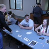 "Chadron State College student Jeremiah Fink, standing, discusses ""Don't Drive In'Text'icated"" with Rulon Taylor, left, and Lexis Ferguson, right, students enrolled in Dr. Josh Ellis' Weight of the Nation course. (Photo By Alex Coon/Chadron State College)"