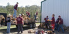 Members of the Chadron State College Phi Beta Lambda club unload and stack a trailer of firewood at a home south of Chadron during The Big Event Saturday, April 22, 2017. (Photo by Kelsey R. Brummels/Chadron State College)