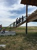 Area 4-H and FFA youth climb the stairs into the Chadron State College Rangeland Complex between outdoor and indoor sessions of the Nebraska Extension's Plant Identification, Collection and Range Judging Contest July 12, 2017. (Tena L. Cook/Chadron State College)