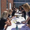 Volunteers sign in for The Big Event at the Chicoine Center Saturday, April 22, 2017. (Photo by Tena L. Cook/Chadron State College)