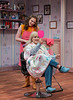 "Truvy, played by Jennaya Hill, checks her hair with Annelle, played by Courtney Smith, during Chadron State College's production of ""Steel Magnolias,"" by Robert Harling. (Photo by Daniel Binkard/Chadron State College)"