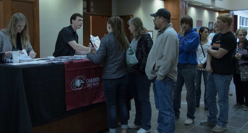 Prospective Chadron State College students and family members check in for Signing Day in the CSC Student Center, April 21, 2017. (Photo by Kelsey R. Brummels/Chadron State College)