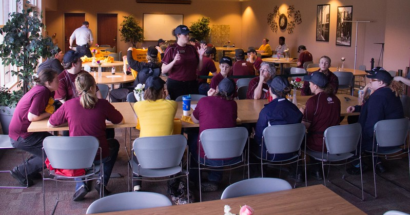 Amber James, retail manager for CSC Dining Services, presents training before the attempt at the world's longest taco line record during Spring Daze, Friday, April 21, 2017. (Photo by Tena L. Cook/Chadron State College)