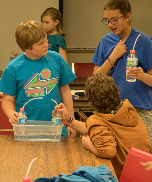 From left, Henry Kennell, Corbin Lutzenhiser, and Blaine Tewahade test their thermometers during Science Saturday at Chadron State College Math and Science Building, Saturday, April 8, 2017. (Photo by Alex Coon/Chadron State College)