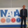 """Chadron State College faculty member Dr. Josh Ellis poses at the National Athletic Trainers Association conference in July 2017 where he presented """"Ketogenic Diet for Sport: What Does the Research Tell Us?"""". Ellis presented about the same topic at the National Strength & Conditioning Association's South Dakota/North Dakota State Clinic in Rapid City in April 2017. (Courtesy photo)"""