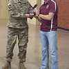 Cadet Joshua Mayer, right, presents a War Eagle to Master Sgt. Jonathan Mudget at the Chadron State College Army ROTC's year-end ceremony. This is Mudget's and Lt. Col. Lynna Speier's last year with the Mount Rushmore Battalion. Mudget will be stationed in Germany with the 25th ACR and Speier is retiring after 22 years of service. (Courtesy photo)