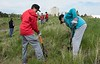 Chadron Middle School students Shawn Schremmer, left, and Collin Brennan dig holes to plant wild American plums donated by the Upper Niobrara White Natural Resource District near Eagle Ridge May 22, 2017. (Photo by Tena L. Cook/Chadron State College)