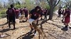 Jacob Norris and other CSC football team members spread wood chips at Wilson Park during The Big Event Saturday, April 22, 2017. (Photo by Alex Coon/Chadron State College)