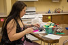 Chadron State College student Shaylynn Montes of Duluth, Minn., creates a project with feathers in Dr. Kim Madsen's Play, Art, Music and Movement class (EDUC 231) Feb. 19, 2020. February is national Career and Technical Education month.  (Photo by Tena L. Cook/Chadron State College)