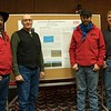 Chadron State College student William Krause of Spring Branch, Texas, right, poses with representatives of Terrell Farms. Krause presented a poster about his observations of the Terrell farms operation during Range Day Jan. 16, 2018, int he CSC Student Center. From left, Dennis Laws, Vern Terrell and Brock Terrell. Krause will compete in the Society for Range Management's national conference in Reno, Nevada, Jan. 28-Feb. 2, 2018. (Photo by Tena L. Cook/Chadron State College)