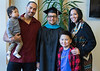 Graduate Christian McGhee, of Pine Ridge, S.D., center, poses with friends following Chadron State College's Graduate Winter Commencement Friday, Dec. 14, 2018, in Memorial Hall. From left, Raynor Aden Whitcombe holding Manaia Whitcombe, Sunny Red Bear, and Acea Red Bear Giago in front. (Tena L. Cook/Chadron State College)