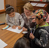 Chadron State College student Kelsey Channer of Arthur, Neb., center, helps Kindergarten students from Wolf Creek Elementary School near Pine Ridge, S.D., during Dr. Seuss Day Wednesday, Feb. 27, 2019, at CSC as part of Read Across America. (Tena L. Cook/Chadron State College) (Tena L. Cook/Chadron State College)