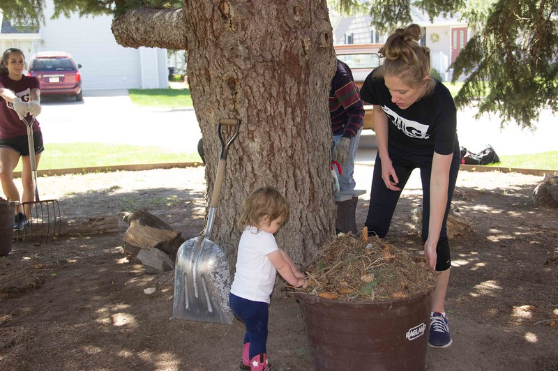 Erin Heide and her daughter help the dance team members with yard work at the Methodist Church Saturday, April 22, 2017, during the 5th Annual The Big Event. (Photo by Tena L. Cook/Chadron State College)